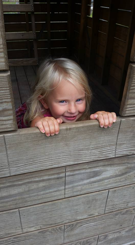 Children's Orchard little girl in playhouse