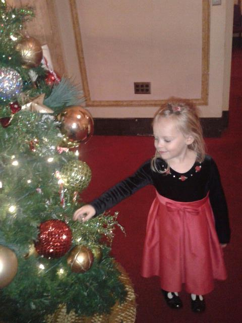 Children's Orchard little girl and Christmas tree